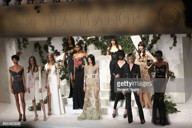 Kendall Jenner poses with models on the runway during La Perla Fall/Winter 2017 RTW Show at SIR Stage 37 on February 9 2017 in New York City
