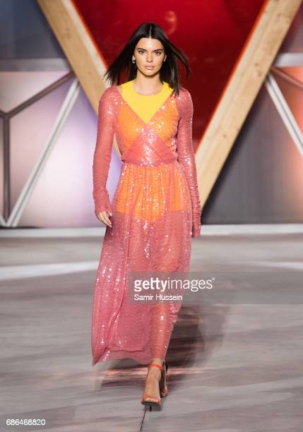Kendall Jenner walks the runway at the Fashion for Relief event during the 70th annual Cannes Film Festival at Aeroport Cannes Mandelieu on May 21...