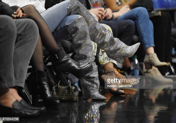 Kendall Jenner wearing a pair of $10000 Saint Laurent boots attends the Los Angeles Clippers and Memphis Grizzlies basketball game at Staples Center...