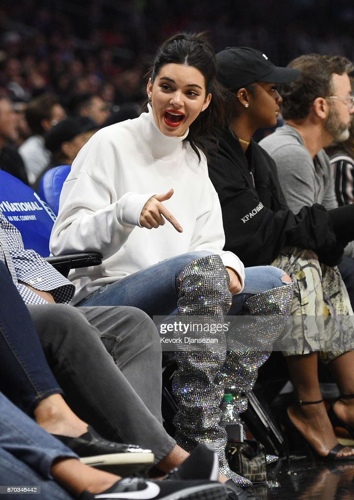 Kendall Jenner sparkled in her $10K YSL bedazzled boots courtside at the Clippers game last Saturday.