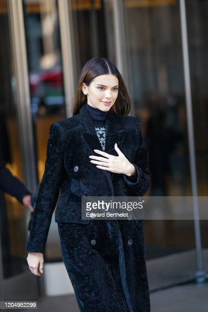 Kendall Jenner wears a turtleneck pullover, a black fluffy long coat, outside Longchamp, during New York Fashion Week Fall-Winter 2020, on February...