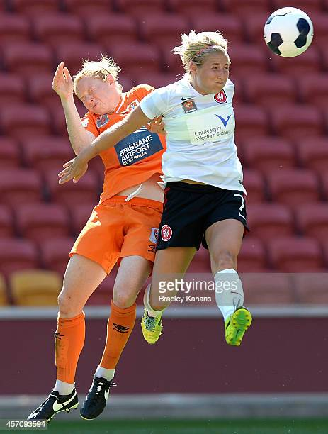 Kendall Johnson of the Wanderers is challenged by the defence of Clare Polkinghorne of the Roar during the round five WLeague match between the...