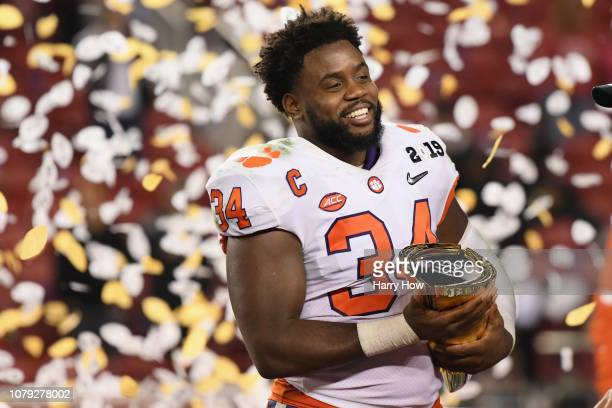Kendall Joseph of the Clemson Tigers celebrates his teams 4416 win over the Alabama Crimson Tidewith the trophy in the CFP National Championship...