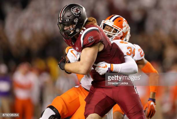 Kendall Joseph of the Clemson Tigers tries to stop Hayden Hurst of the South Carolina Gamecocks during their game at WilliamsBrice Stadium on...