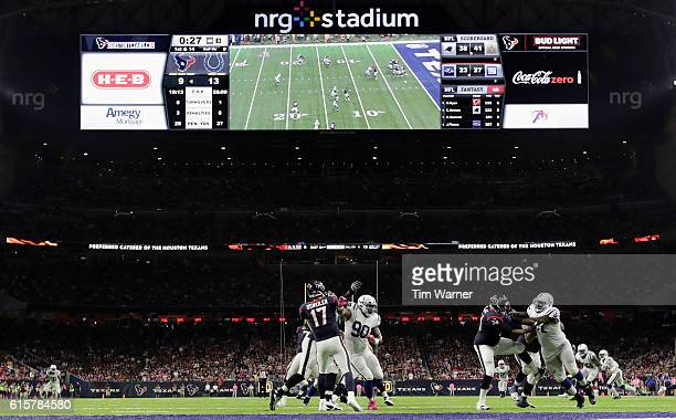 Kendall Langford of the Indianapolis Colts pressures Brock Osweiler of the Houston Texans near the goal line in the third quarter during the NFL game...