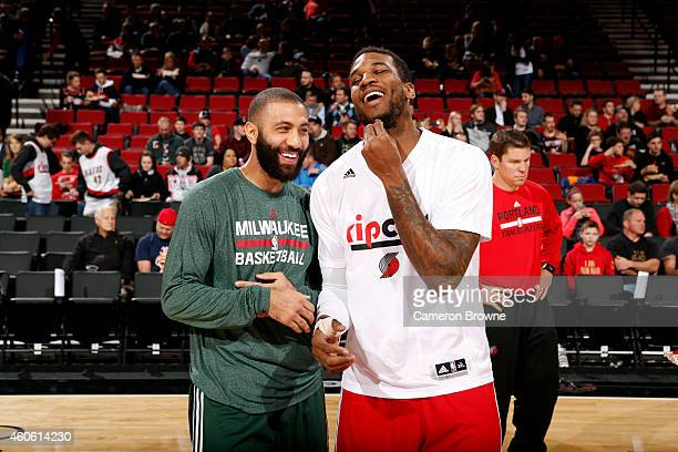 Kendall Marshall of the Milwaukee Bucks and Thomas Robinson of the Portland Trail Blazers share a laugh before a game on December 17 2014 at the Moda...