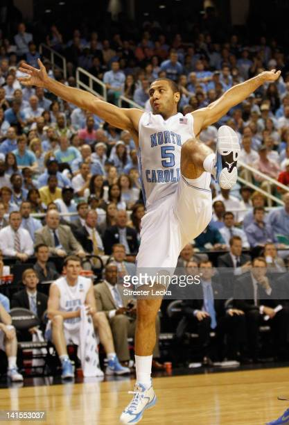 Kendall Marshall of the North Carolina Tar Heels is fouled by Ethan Wragge of the Creighton Bluejays in the second half during the third round of the...