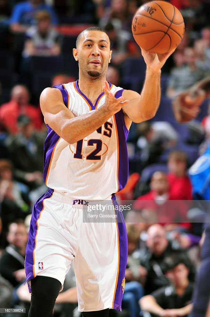 Kendall Marshall #12 of the Phoenix Suns passes the ball against the Dallas Mavericks on February 1, 2013 at U.S. Airways Center in Phoenix, Arizona.