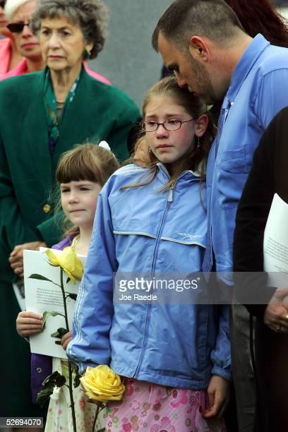 Kendall Mayo and Cailin Mayo stand with their father, Doug Mayo