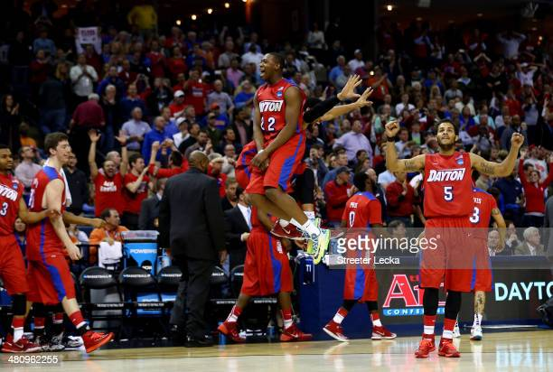 Kendall Pollard and Devin Oliver of the Dayton Flyers celebrate after defeating the Stanford Cardinal 8272 in a regional semifinal of the 2014 NCAA...