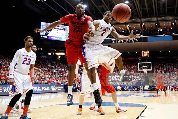 Kendall Pollard of the Dayton Flyers and Derrick Marks of the Boise State Broncos battle for a loose ball during the first round of the 2015 NCAA...