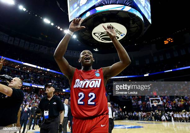 Kendall Pollard of the Dayton Flyers celebrates after defeating the Stanford Cardinal 8272 in a regional semifinal of the 2014 NCAA Men's Basketball...