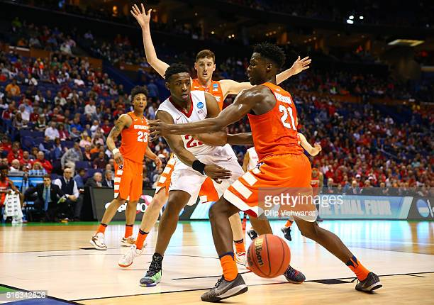 Kendall Pollard of the Dayton Flyers looks to pass against Tyler Lydon and Tyler Roberson of the Syracuse Orange in the first half during the first...