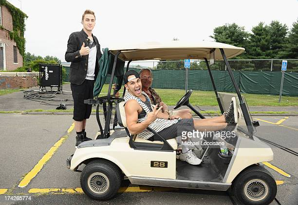 Kendall Schmidt and Carlos Pena Jr of Nickelodeon's Big Time Rush get ready to perform during their free concert for families on July 22 2013 in...