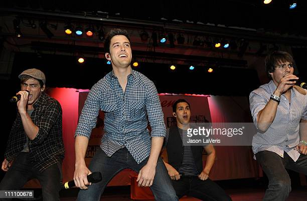 Kendall Schmidt Logan Henderson Carlos Pena Jr and James Maslow of Big Time Rush perform at Torrance High School on March 29 2011 in Torrance...