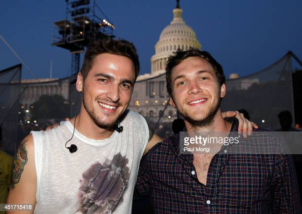 Kendall Schmidt poses for a photo with Phillip Phillips backstage at PBS's 2014 A CAPITOL FOURTH at US Capitol West Lawn on July 4 2014 in Washington...