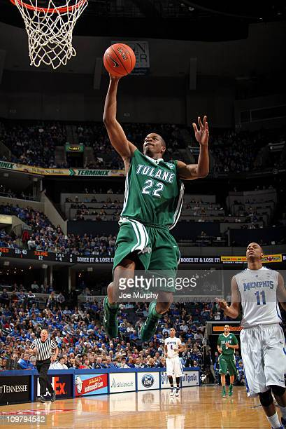 Kendall Timmons of the Tulane Green Wave goes up for a dunk past Wesley Witherspoon of the Memphis Tigers on March 5 2011 at FedExForum in Memphis...