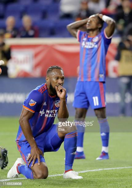 Kendall Waston and Darren Mattocks of FC Cincinnati react to a missed shot in the second half against the New York Red Bulls at Red Bull Arena on...
