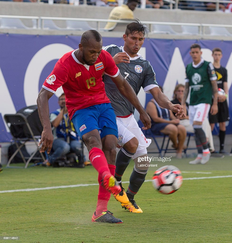 Kendall Waston (#19) of Costa Rica crosses the ball as Jorge Benitez (#7) of Paraguay challenges in the group A match between Costa Rica and Paraguay at Camping World Stadium as part of Copa America Centenario US 2016 on June 04, 2016 in Orlando, Florida, US.