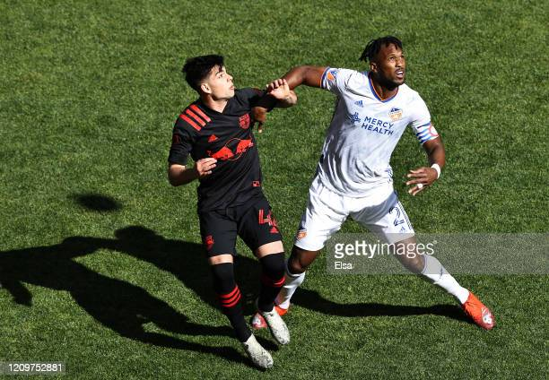 Kendall Waston of FC Cincinnati and Brian White of New York Red Bulls fight for position in the first half at Red Bull Arena on March 01, 2020 in...
