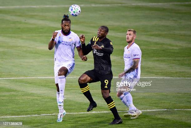 Kendall Waston of FC Cincinnati and Fanendo Adi of Columbus Crew compete for the ball during their game at MAPFRE Stadium on September 06 2020 in...