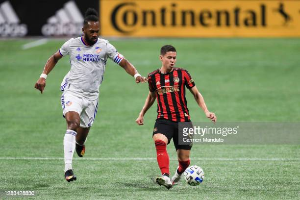 Kendall Waston of FC Cincinnati chases after Matheus Rossetto of Atlanta United during the first half at MercedesBenz Stadium on November 01 2020 in...