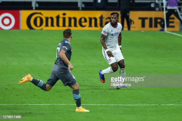 Kendall Waston of FC Cincinnati dribbles the ball while Robin Lod of Minnesota United defends in the second half of the game at Allianz Field on...