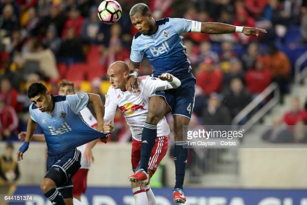 Kendall Waston of Vancouver Whitecaps heads clear while challenged by Aurelien Collin of New York Red Bulls during the New York Red Bulls Vs...