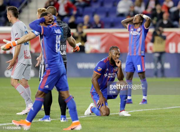 Kendall Waston,Allan Cruz and Darren Mattocks of FC Cincinnati react to a missed shot in the second half against the New York Red Bulls at Red Bull...