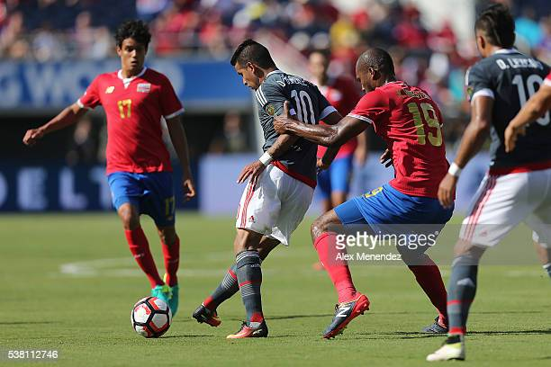 Kendall Watson of Costa Rica grabs Derlis Gonzalez of Paraguay during the 2016 Copa America Centenario Group A match between Costa Rica and Paraguay...