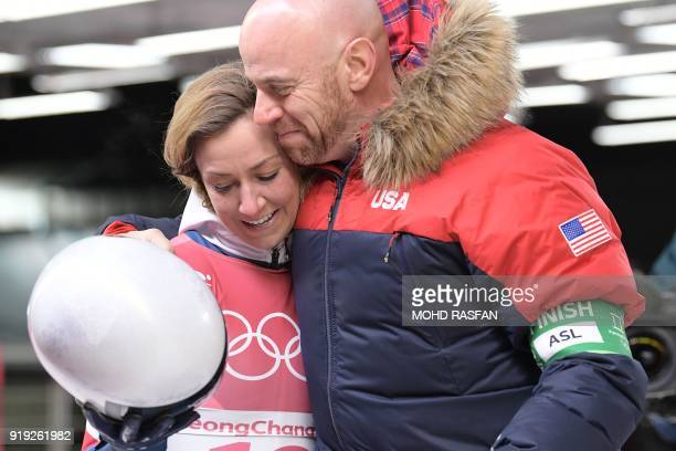 US Kendall Wesenberg hugs a team member after finishing in the women's skeleton heat 4 final run during the Pyeongchang 2018 Winter Olympic Games at...