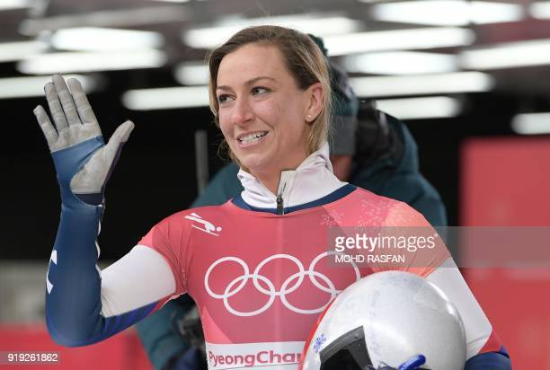 US Kendall Wesenberg waves after finishing in the women's skeleton heat 4 final run during the Pyeongchang 2018 Winter Olympic Games at the Olympic...