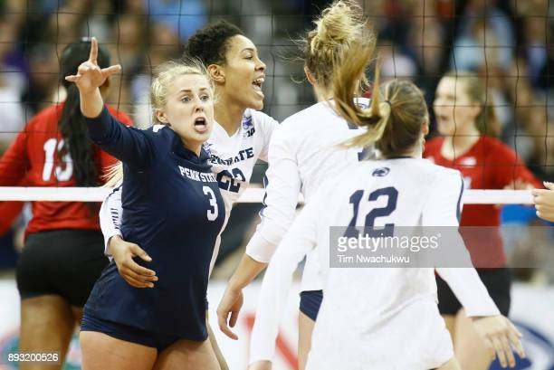 Kendall White and Simone Lee of Penn State University celebrate a point against the University of Nebraska during the Division I Women's Volleyball...