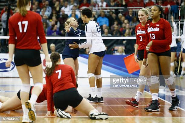 Kendall White and Simone Lee of Penn State University react after scoring against the University of Nebraska during the Division I Women's Volleyball...
