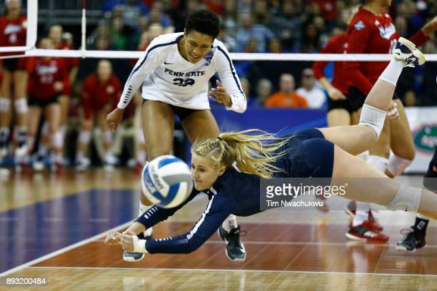 Kendall White of Penn State University dives for a ball while taking on the University of Nebraska during the Division I Women's Volleyball...