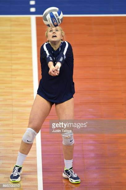 Kendall White of Penn State University hits a return against the University of Nebraska during the Division I Women's Volleyball Semifinals held at...