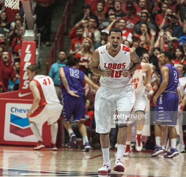 Kendall Williams of the New Mexico Lobos celebrates after teammate Cameron Bairstow slammed for two points during the game against the Grand Canyon...