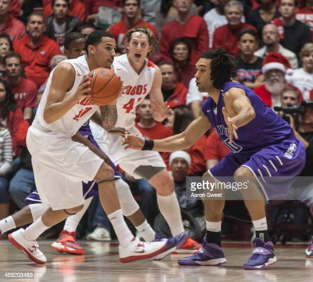 Kendall Williams of the New Mexico Lobos runs the ball to the basket around defender Blake Davis of the Grand Canyon Antelopes during the Monday...