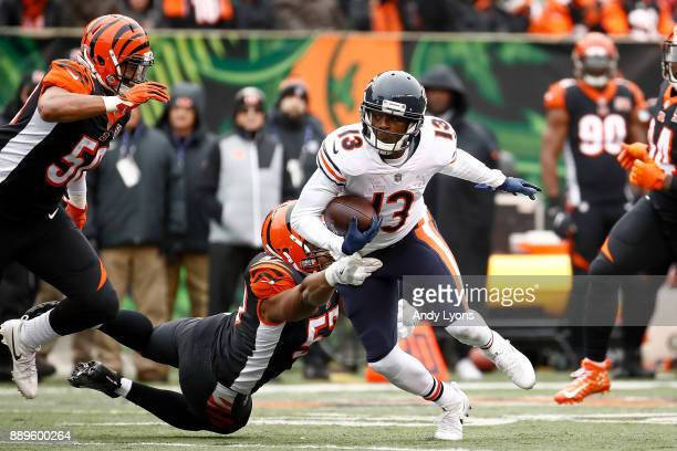 Kendall Wright of the Chicago Bears breaks a tackle from Vincent Rey of the Cincinnati Bengals during the first half at Paul Brown Stadium on...