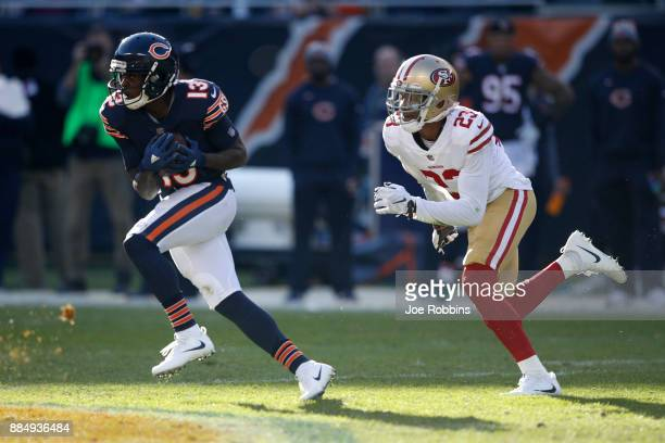 Kendall Wright of the Chicago Bears carries the football ahead of Ahkello Witherspoon of the San Francisco 49ers in the third quarter at Soldier...