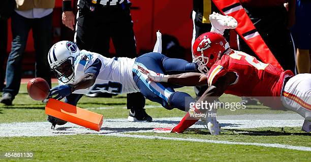 Kendall Wright of the Tennessee Titans dives in for a touchdown against Sean Smith of the Kansas City Chiefs during the third quarter at Arrowhead...