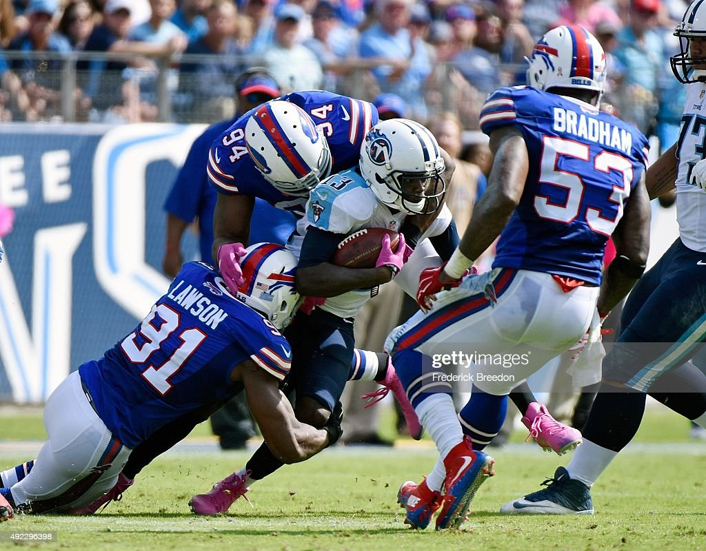 Kendall Wright #13 of the Tennessee Titans is gang tackled by members of the Buffalo Bills during the first half of a game at Nissan Stadium on October 11, 2015 in Nashville, Tennessee.