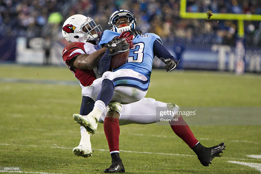 Kendall Wright #13 of the Tennessee Titans is tackled by Daryl Washington #58 of the Arizona Cardinals at LP Field on December 15, 2013 in Nashville, Tennessee. The Cardinals defeated the Titans 37-34.