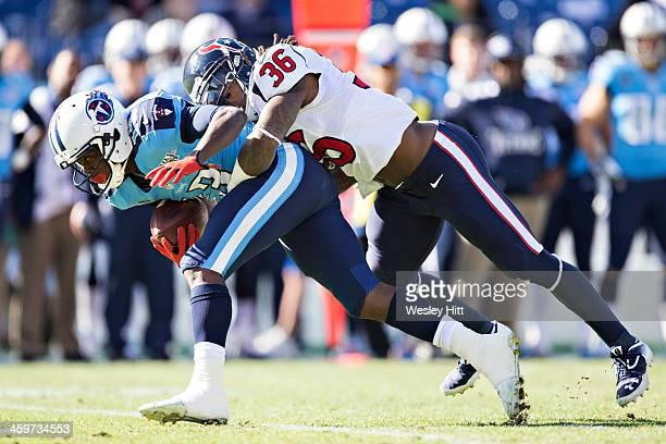 Kendall Wright of the Tennessee Titans is tackled by DJ Swearinger of the Houston Texans at LP Field on December 29 2013 in Nashville Tennessee The...
