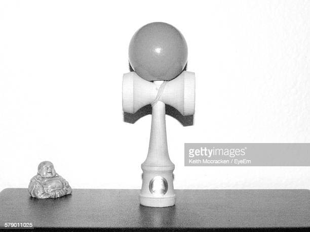 Kendama On Table Against White Wall