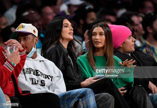 Kendell Jenner, Hailey and Justin Bieber attend the Los Angeles Lakers and Phoenix Suns game at Staples Center on October 22, 2021 in Los Angeles,...
