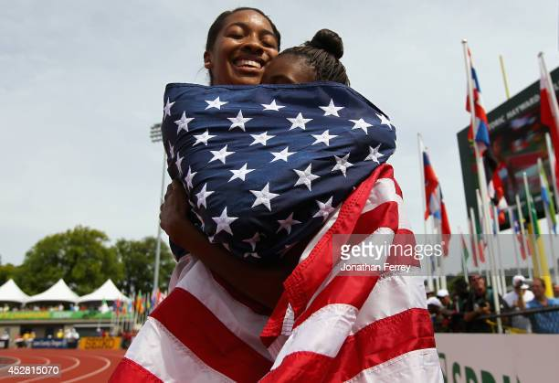 Kendell Williams of the US celebrates winning the gold medal in the women's 100m hurdle final with silver medalist Dior Hall of the US during day six...