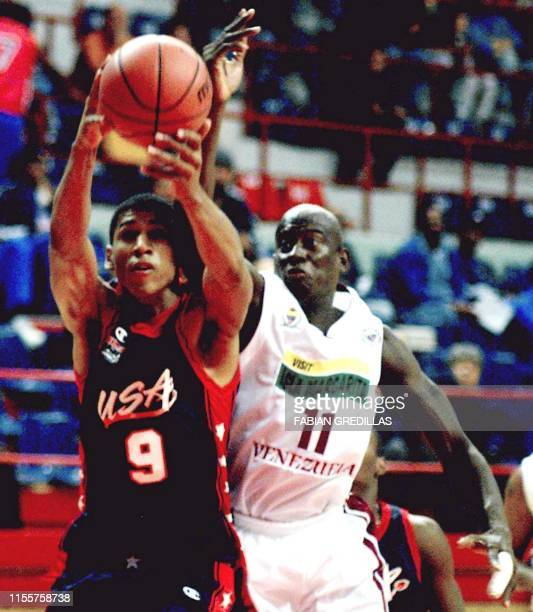 Kendolf Dartez of the United States, fights for the ball with Carl Herrera , of Venezuela, during a qualifying game at the Ruca-Che gymnasium in...