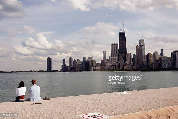 Kendra Bucher and Jeff Johnson stare out over the waters of Lake Michigan at North Avenue Beach May 27, 2005 in Chicago, Illinois. Chicago opened its...