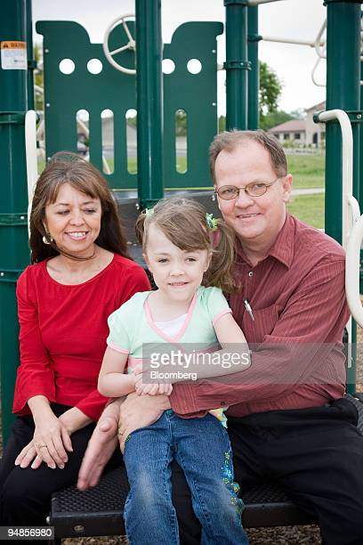 Kendra Dyer center poses with her parents Marshall right and Natia at a park in Broken Arrow Oklahoma US on Tuesday May 6 2008 Kendra was born four...